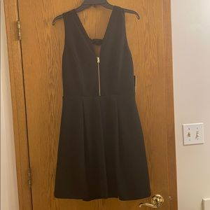 "A ""Must Have"" Black Mini-Dress by Guess"